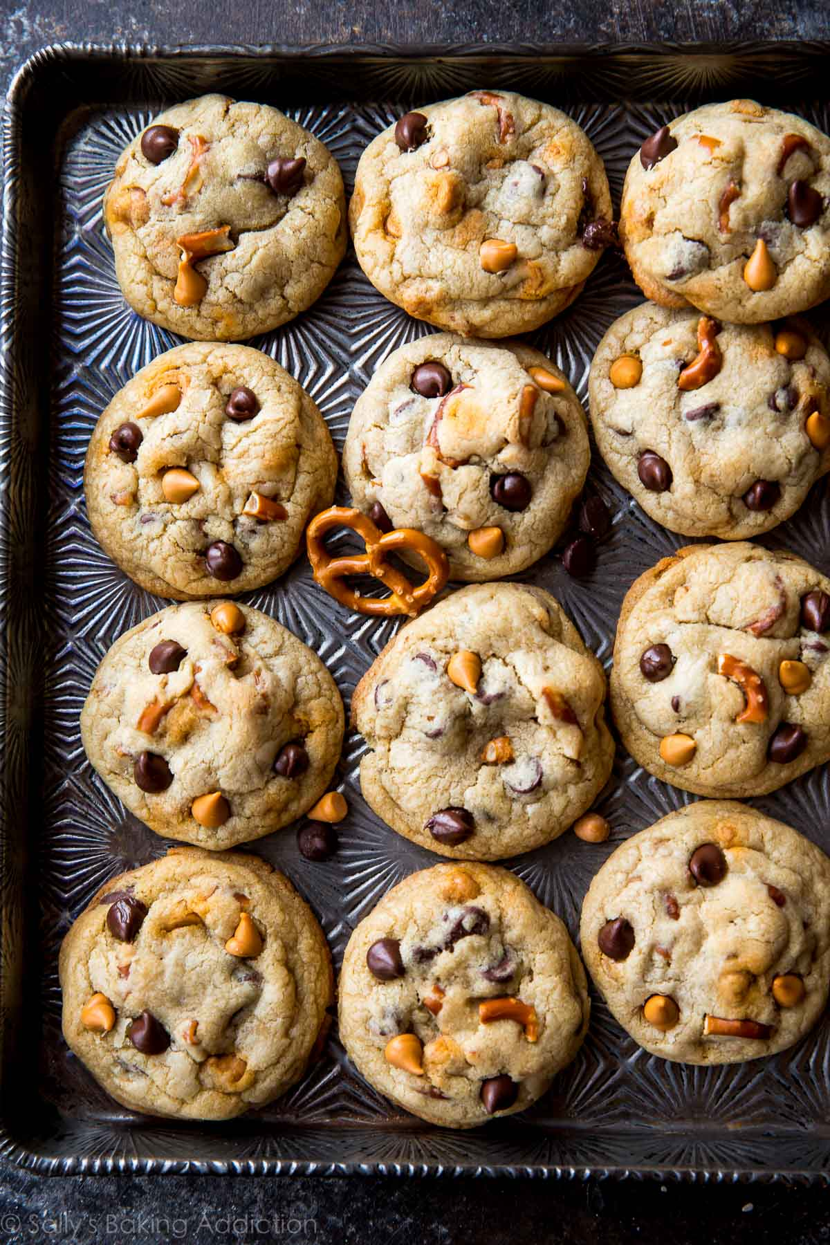 Sweet, salt, soft, and crispy these butterscotch pretzel chocolate chip cookies are irresistible! Quick and easy recipe on sallysbakingaddiction.com