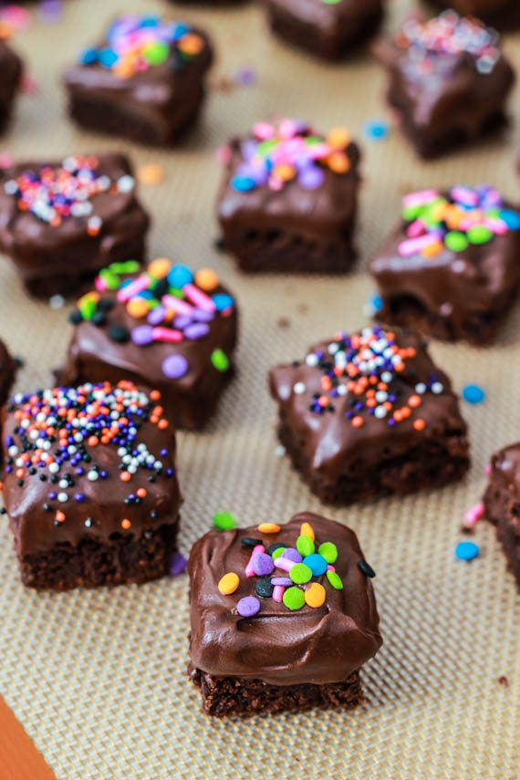 Bite-sized homemade brownies covered in chocolate and sprinkles! Easy recipe at sallysbakingaddiction.com