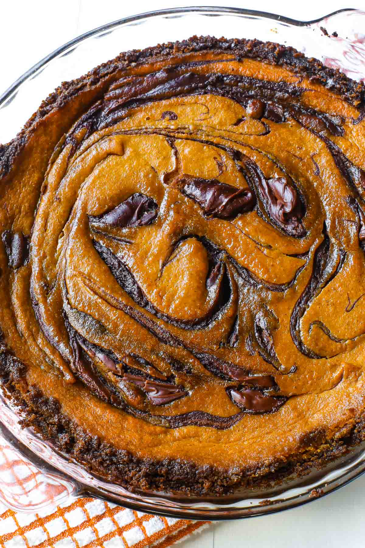 A twist on traditional pumpkin pie - swirled with decadent Nutella and baked in a gingersnap crust. Recipe on sallysbakingaddiction.com