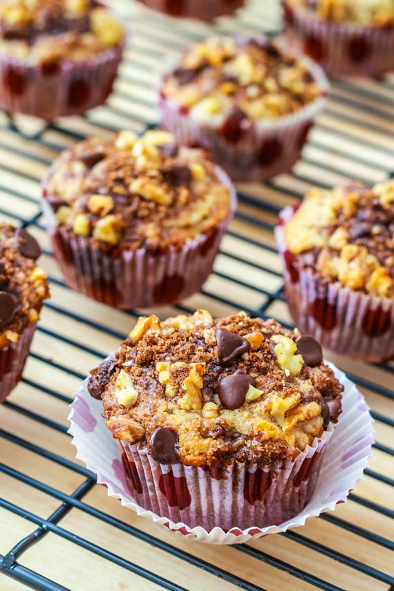 Super-moist and flavorful banana chocolate chip muffins stuffed and topped with cinnamon streusel!