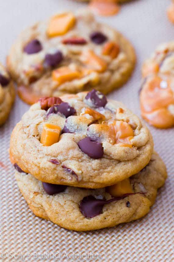 Soft-Baked Salted Caramel Pecan Chocolate Chip Cookies. Find the simple recipe at sallysbakingaddiction.com