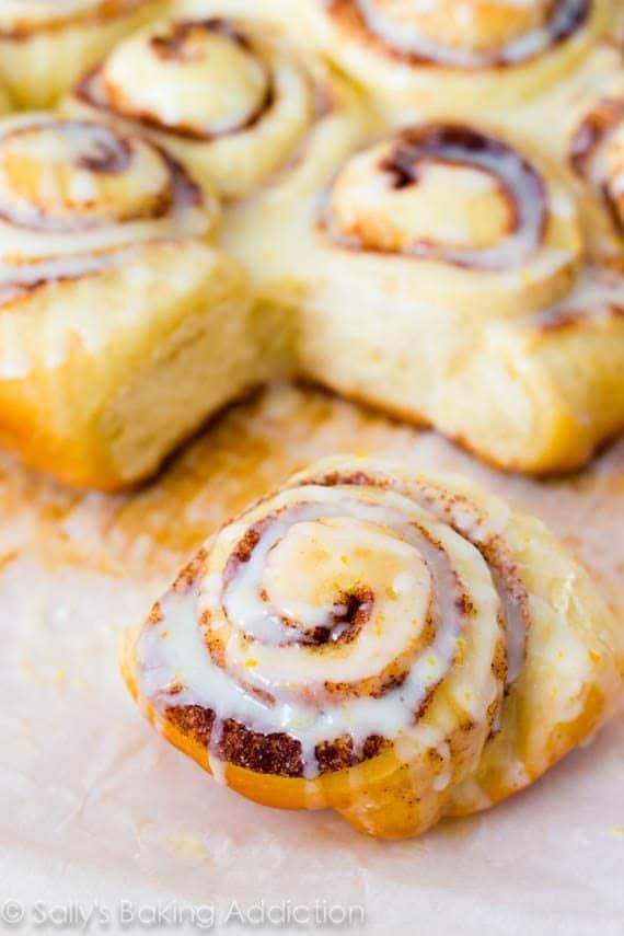 Fluffy Cinnamon Rolls with sweet orange glaze.   Recipe by sallysbakingaddiction.com