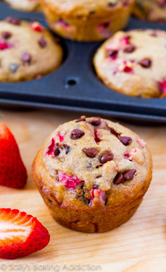 "Incredible ""lightened-up"" chocolate chip muffins with fresh strawberries. Nearly fat-free and only 140 calories each! @sallybakeblog"