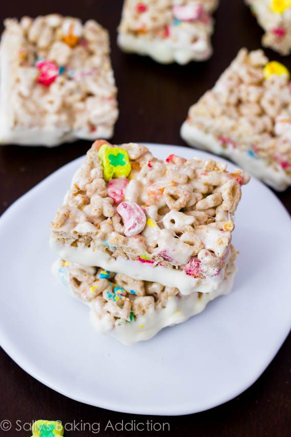Lucky Charms Rice Krispie Treats loaded with marshmallows and white chocolate. Recipe by sallysbakingaddiction.com