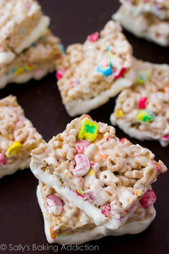 No-Bake Lucky Charms Rice Krispie Treats loaded with marshmallows and white chocolate. Recipe by sallysbakingaddiction.com