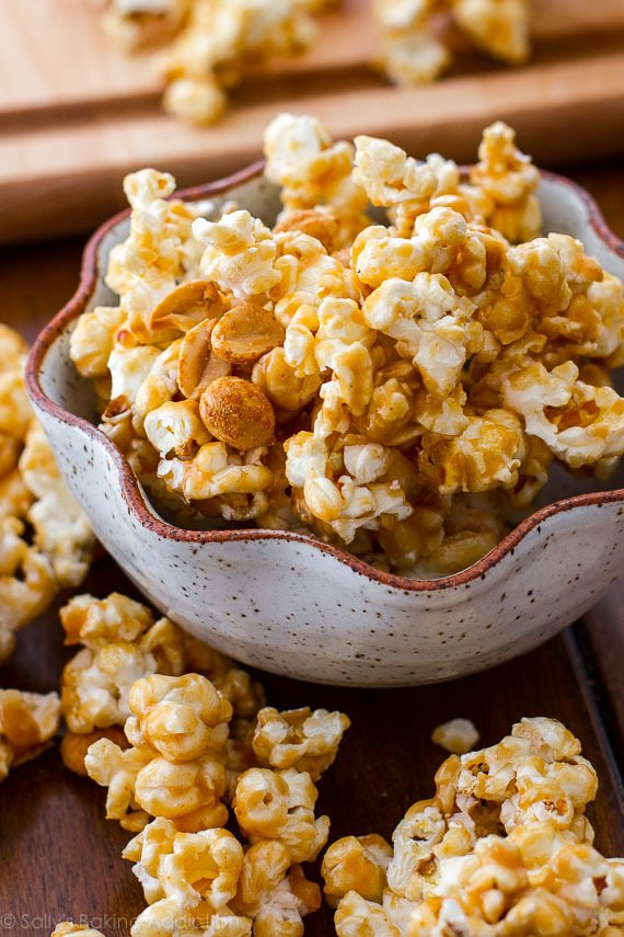Easy and addicting peanut butter caramel corn! The peanut butter caramel sauce only has 3 ingredients! Recipe on sallysbakingaddiction.com