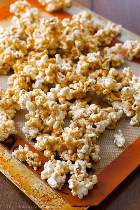 Easy and addicting peanut butter caramel corn! The peanut butter caramel sauce only has 3 ingredients! Recipe on sallysbakingaddiction.com