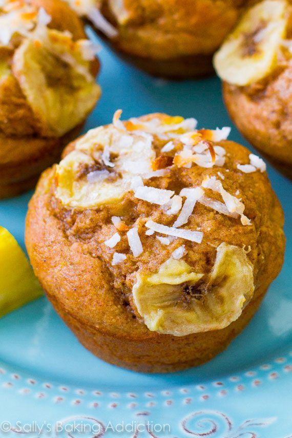 Lightened-up muffins with bananas, pineapple, orange zest, yogurt, whole wheat flour, and coconut. Easy, moist, low-fat, healthy muffins! found on sallysbakingaddiction.com