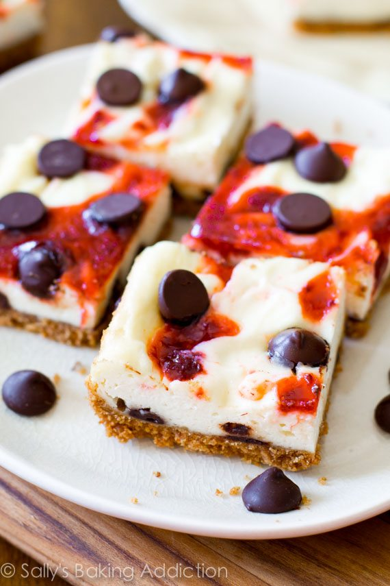 Creamy cheesecake swirled with strawberries and dotted with chocolate chips. These bars are so much easier than making an entire cheesecake!