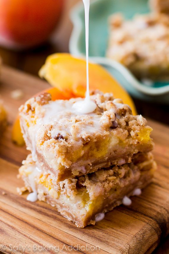 Peaches 'n Cream Bars - enjoy fresh summer peaches in these creamy, juicy bars. Brown sugar crust topped with peach filling, brown sugar streusel and vanilla glaze. Easy to make! sallysbakingaddiction.com