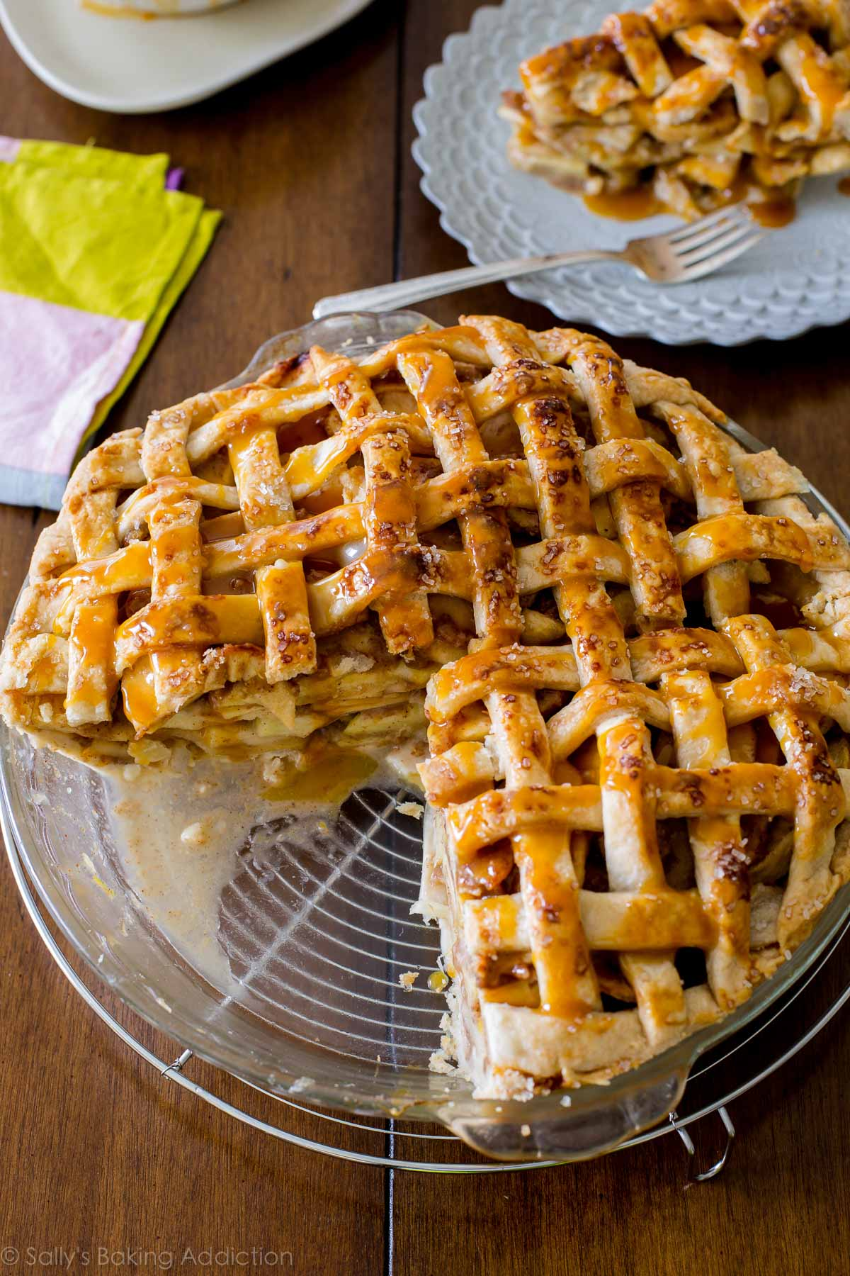 Here is a classic lattice-topped all American apple pie bubbling with salted caramel and gooey, cinnamon apples! Recipe on sallysbakingaddiction.com