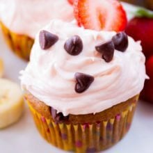 Banana Chocolate Chip Cupcakes topped with tangy strawberry cream cheese frosting. Light, moist, flavorful, irresistible!
