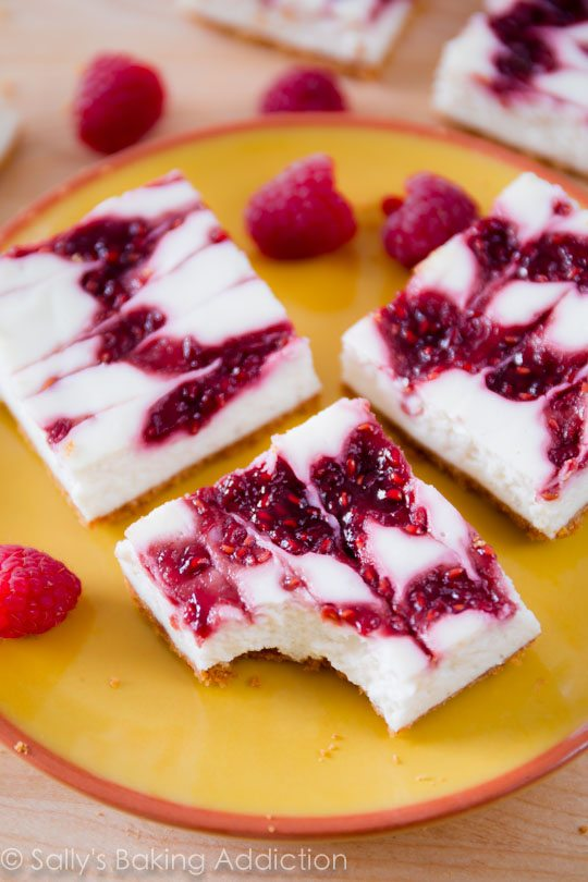 These lightened-up cheesecake bars taste like the real thing! Easy recipe on sallysbakingaddiction.com