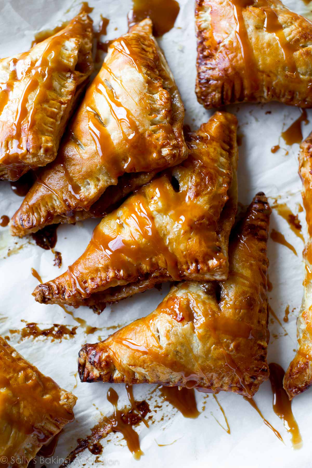Super easy, flaky hot apple turnovers with delicious salted caramel on ...
