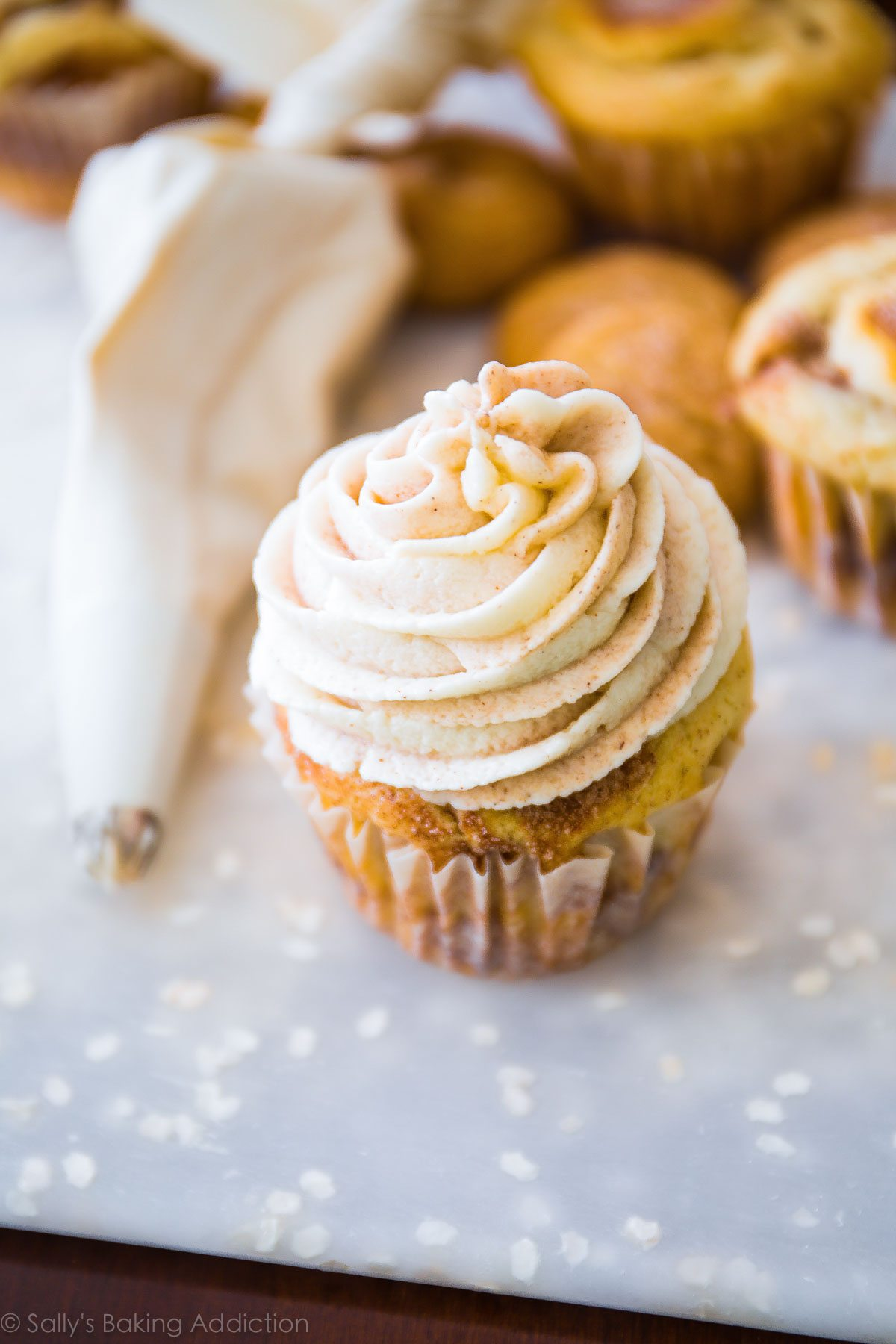 How to make delicious cinnamon swirl snickerdoodle cupcakes! Recipe on sallysbakingaddiction.com