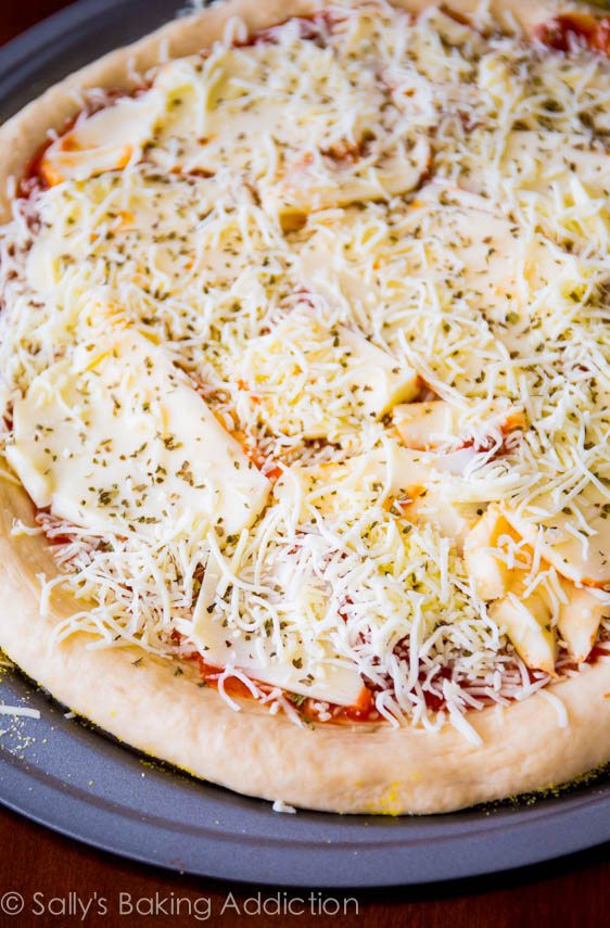 Extra Cheese Pizza on thick-style homemade pizza crust. Step-by-step visual tutorial on sallysbakingaddiction.com
