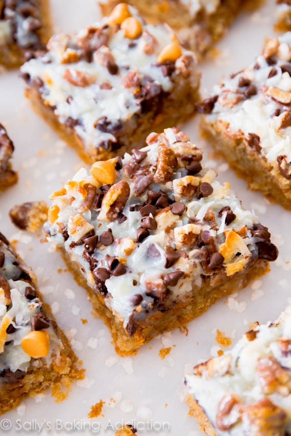 Ultimate Magic Cookie Bars with butterscotch, chocolate, and coconut! Get the recipe at sallysbakingaddiction.com