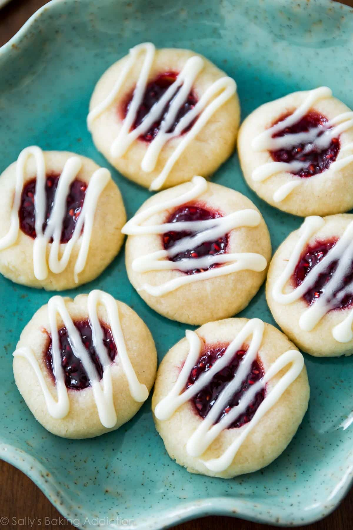 These raspberry almond shortbread cookies are amazing! They're simple to make and you don't need very many ingredients! Recipe on sallysbakingaddiction.com