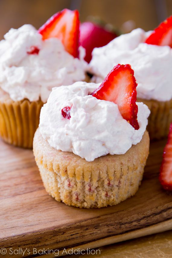Fresh Strawberry Cupcakes made from scratch. Fluffy, sweet, and exploding with strawberry flavor! Recipe at sallysbakingaddiction.com