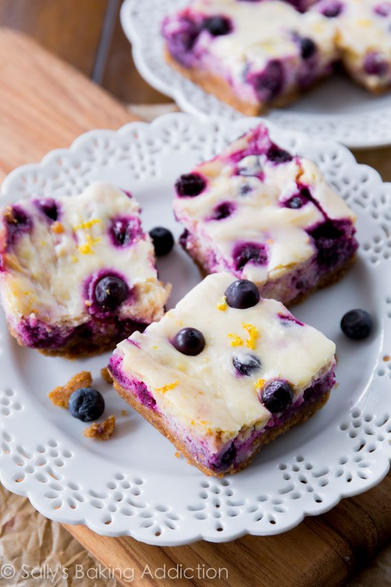 Creamy Lemon Blueberry Cheesecake Bars. So simple to make! sallysbakingaddiction.com