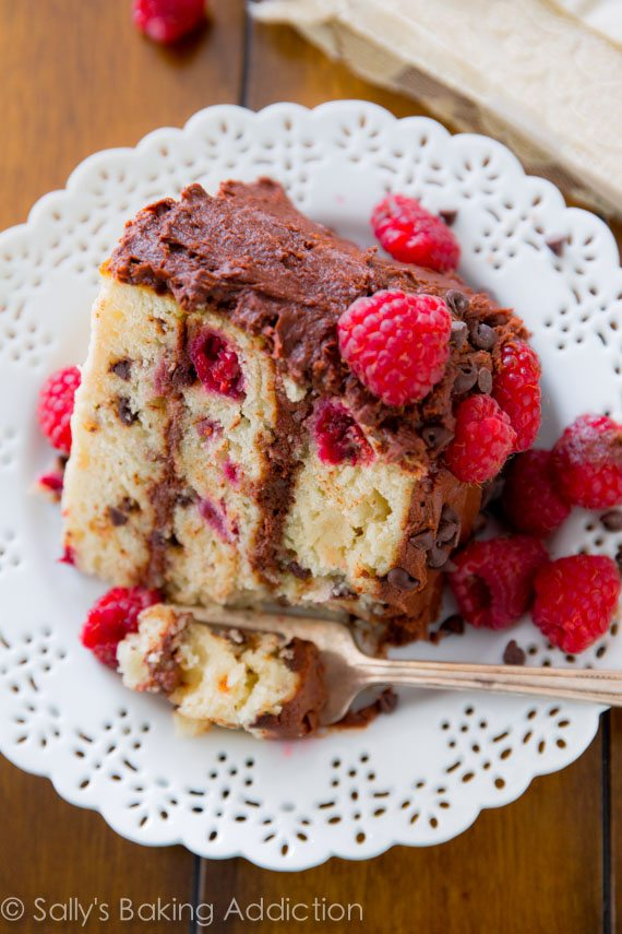 Raspberry Chocolate Chip Layer Cake - super moist chocolate chip cake with raspberries and creamy, velvety milk chocolate frosting. Recipe by sallysbakingaddiction.com