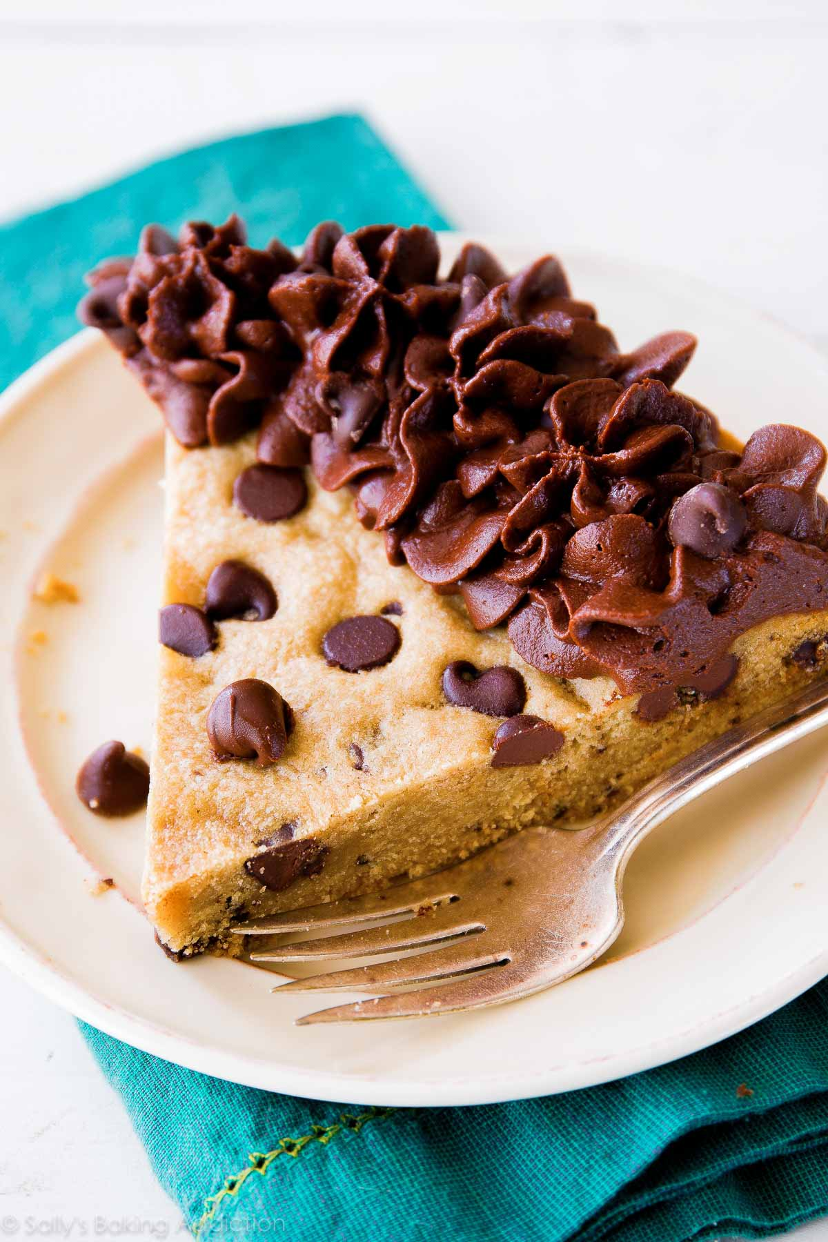 Chocolate Chip Cookie Cake with Milk Chocolate Frosting - the best way to eat a chocolate chip cookie! Recipe on sallysbakingaddiction.com
