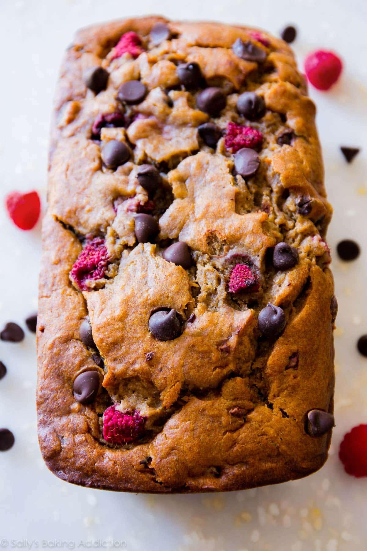 Super-moist and incredibly indulgent brown sugar banana bread with juicy raspberries and dark chocolate chips. My favorite banana bread recipe! sallysbakingaddiction.com