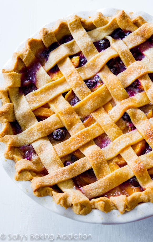 A classic lattice-topped homemade blueberry peach pie bursting with juicy flavor!