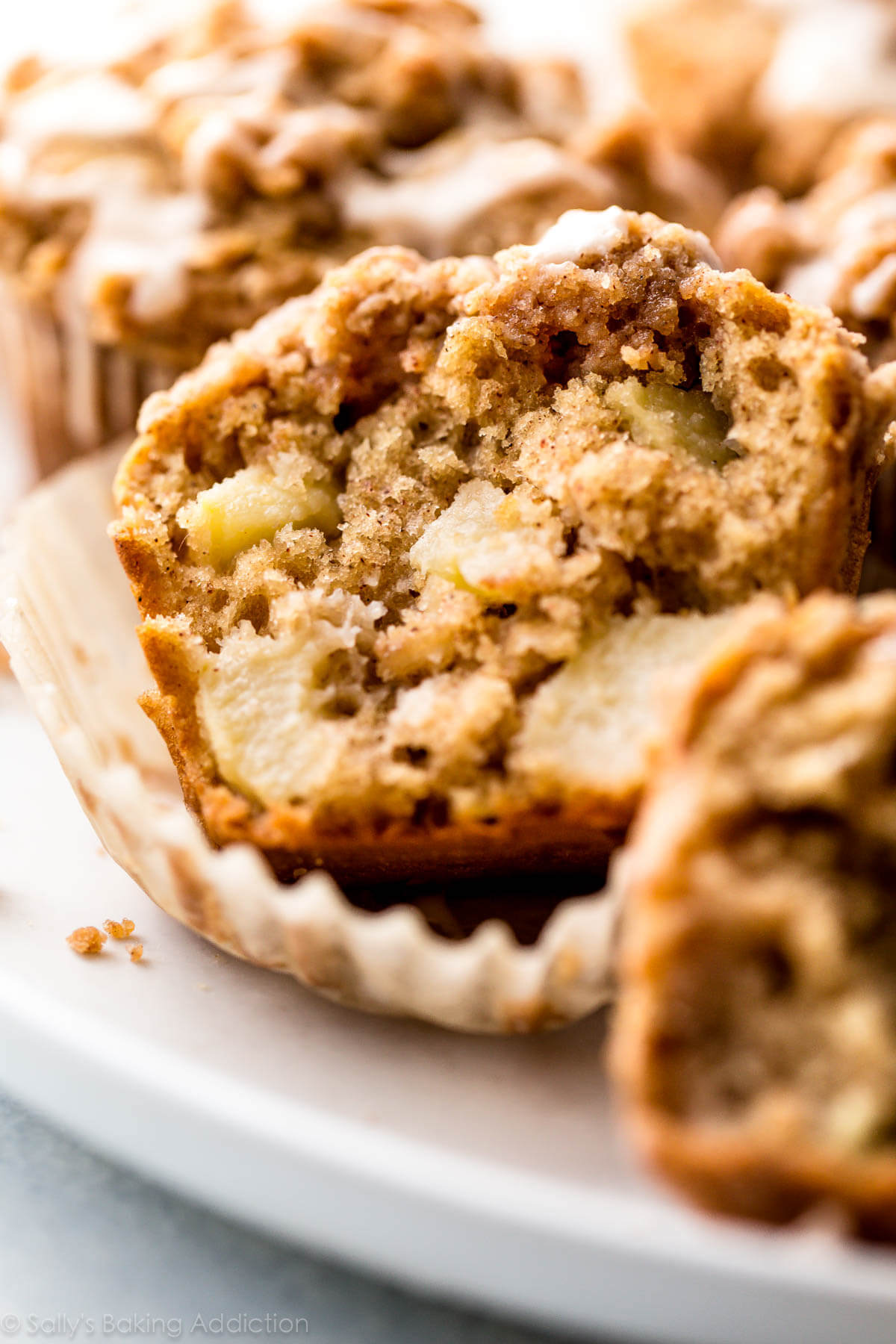 Apple Crumb Muffins are bursting with apples in every single bite! Recipe on sallysbakingaddiction.com