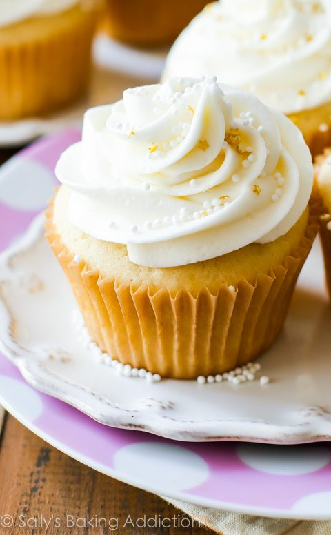 White Wedding Cupcakes - tender and moist homemade vanilla almond cupcakes topped with creamy white chocolate frosting. A truly elegant treat for the most special day.