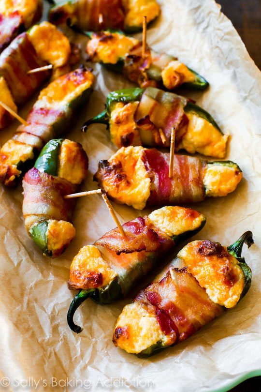 Incredible!! Very easy bacon wrapped jalapeños stuffed with a creamy cheese mix. These are so good! sallysbakingaddiction.com