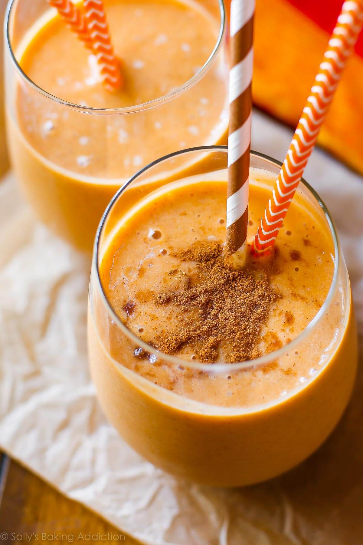 Pumpkin pie smoothie with 12g protein per serving and without all the calories, refined sugar, and fat! Recipe on sallysbakingaddiction.com