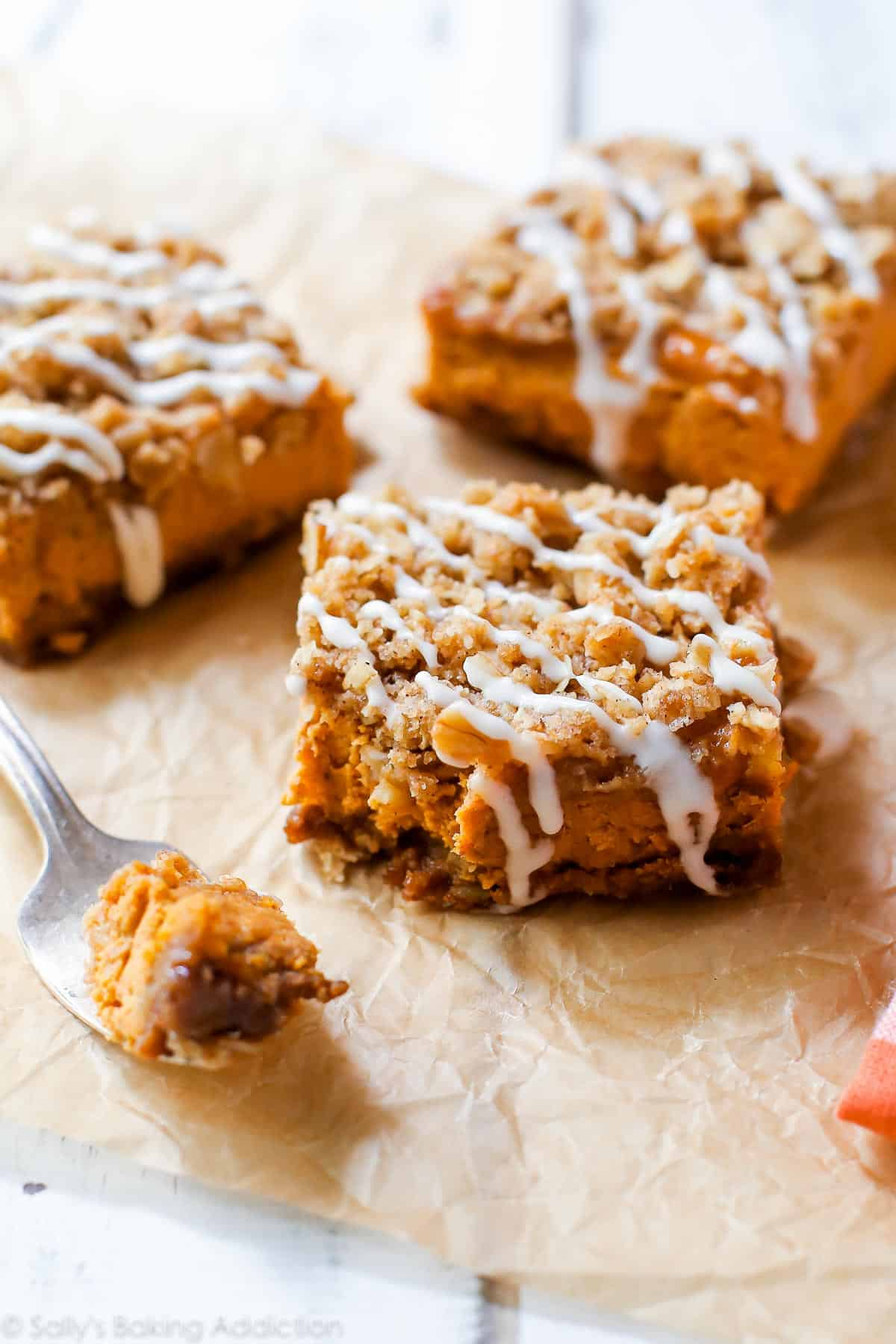 Instead of pumpkin pie this season, try my pumpkin streusel bars. With a gingersnap crust and brown sugar streusel topping, everyone will want seconds! sallysbakingaddiction.com