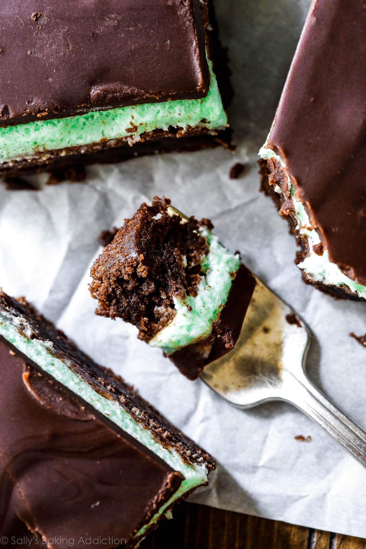 Thick and fudgy brownies layered with sweet mint frosting and easy chocolate ganache. Classic mint chocolate brownies recipe on sallysbakingaddiction.com