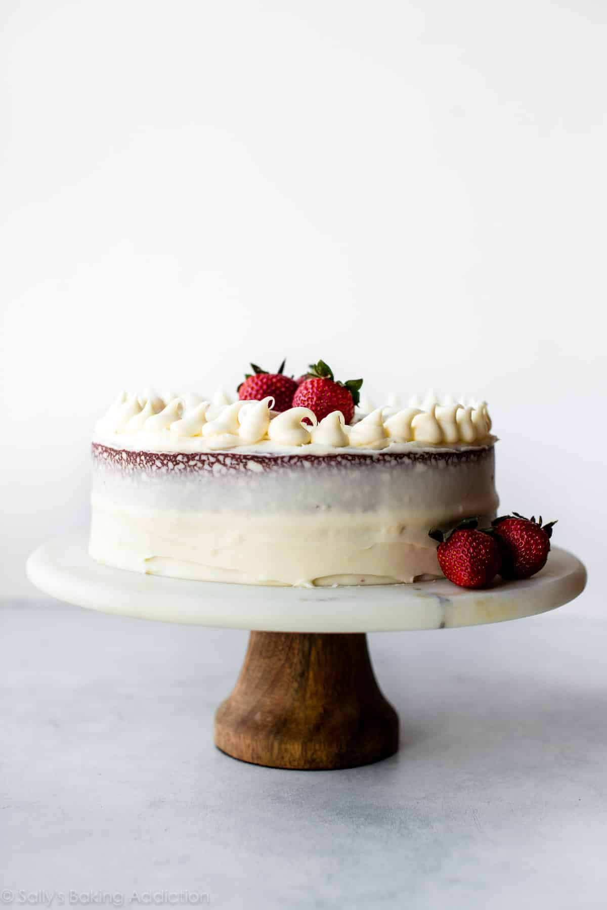 The BEST red velvet cake I've ever had!! Moist, rich, buttery, and topped with cream cheese frosting! Recipe on sallysbakingaddiction.com