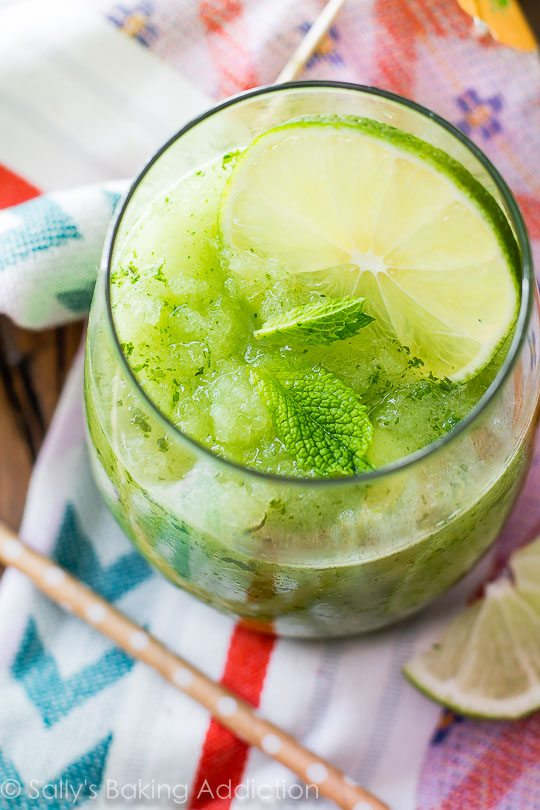 Festive, refreshing, FUN! Whip up these simple Frozen Mojito Slushies tonight. sallysbakingaddiction.com
