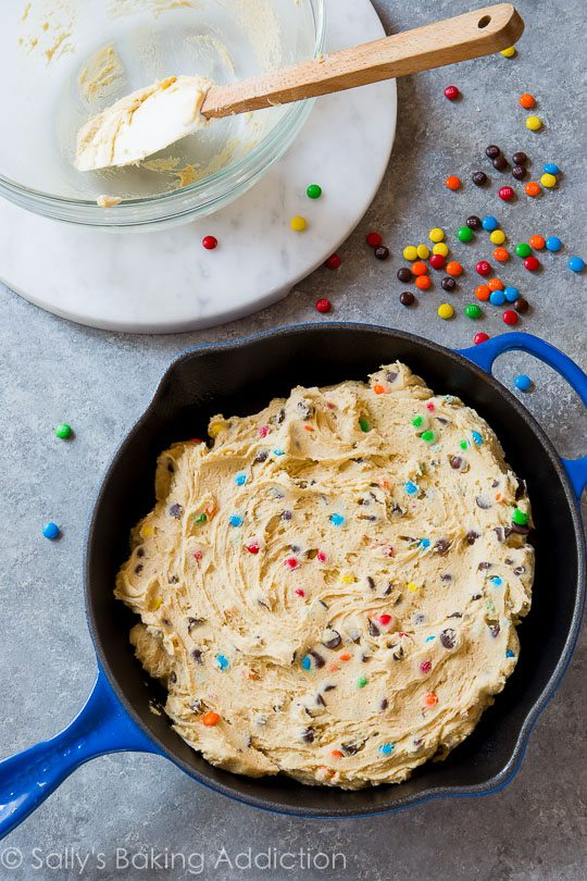 Seriously SIMPLE Chocolate Chip M&Ms Skillet Cookie! Recipe on sallysbakingaddiction.com