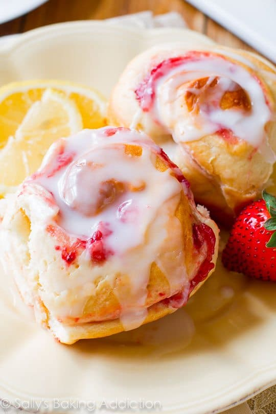 Make-ahead soft & fluffy strawberry rolls with sweet lemon glaze! Grab the recipe on sallysbakingaddiction.com