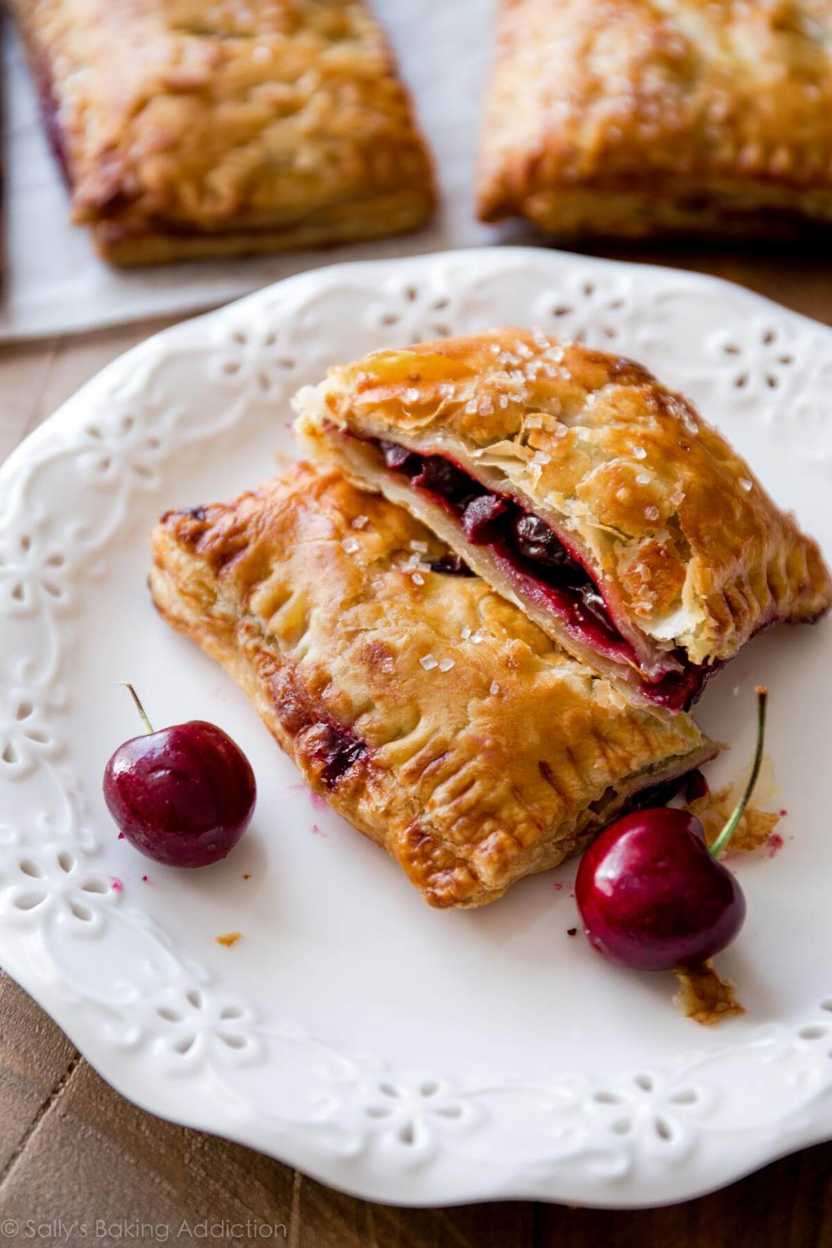 Simple Cherry Pastry Pies are easier than you think! Grab the recipe on sallysbakingaddiction.com