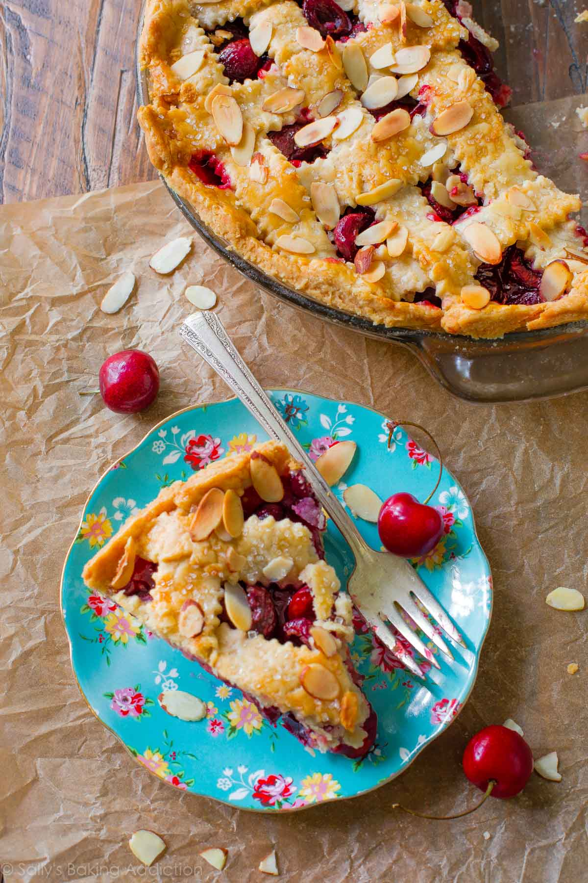Here's how to make a classic fresh cherry pie completely from scratch. Add a little sprinkle of toasted almonds to amp up the flavor! Recipe on sallysbakingaddiction.com