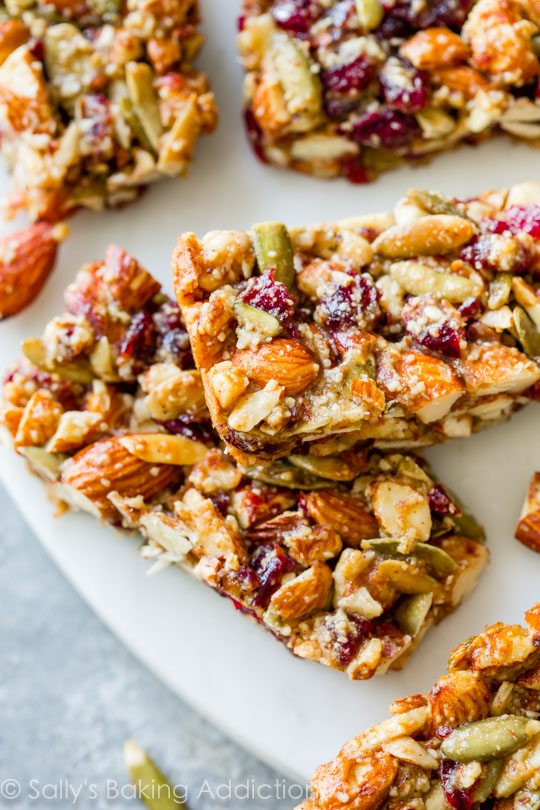 Homemade copycat KIND bars with pumpkin spice, almonds, pumpkin seeds, and dried cranberries. Grain-free and easy to make!