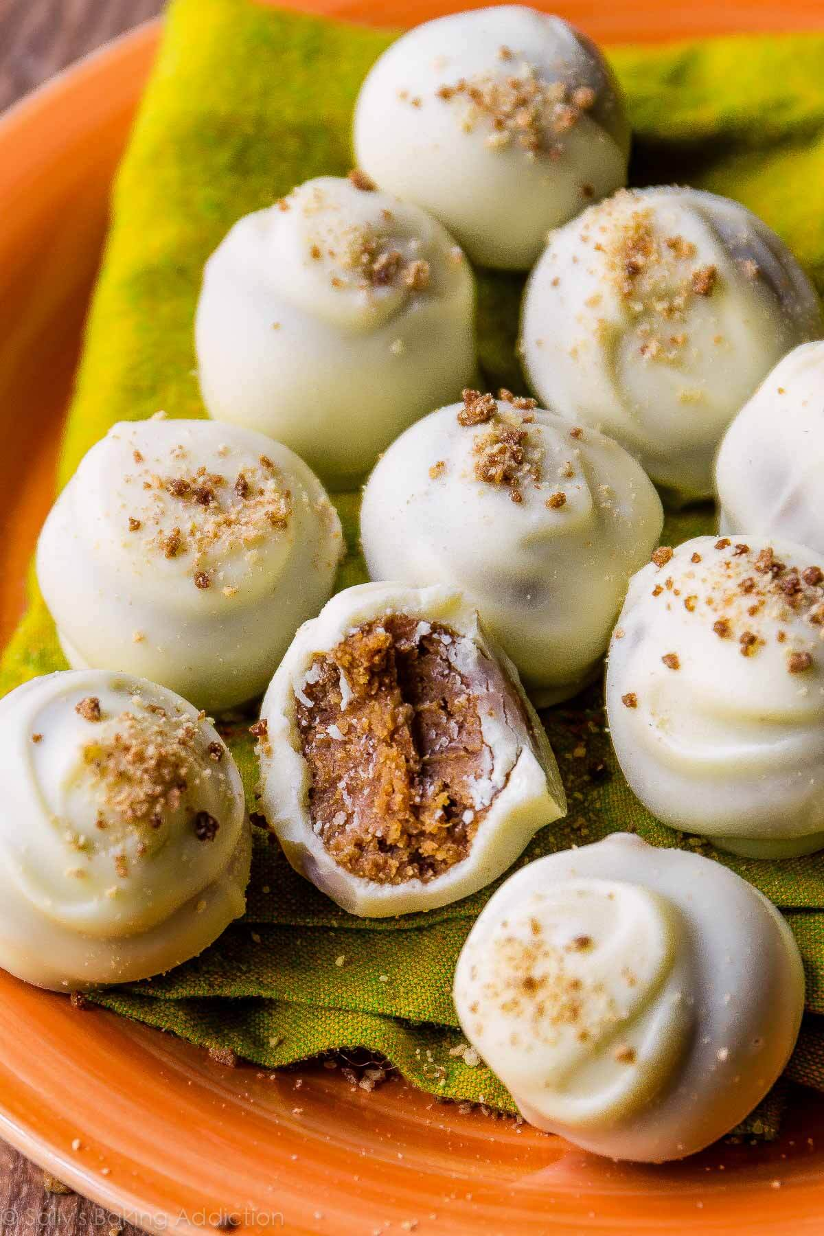 For the best Fall treat, make these pumpkin spice truffles-- they're surprisingly easy and can be coated in white or dark chocolate! Recipe on sallysbakingaddiction.com