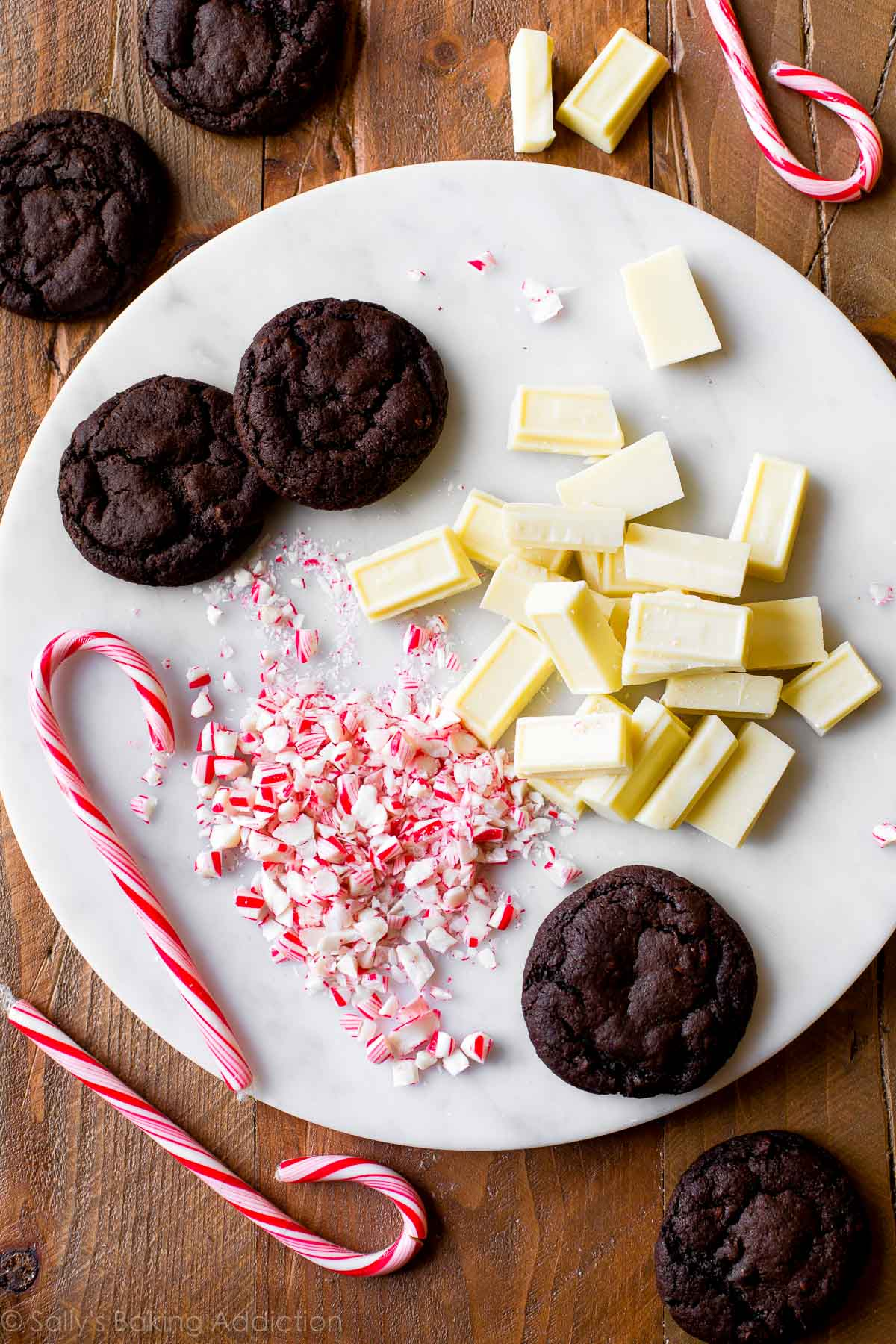 Soft-baked and chewy peppermint mocha cookies! The candy cane crunch and white chocolate put them over the top! Recipe on sallysbakingaddiction.com