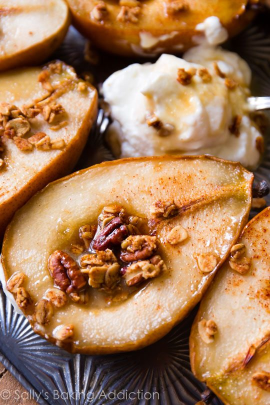 4 ingredient baked pears infused with maple and vanilla! Top with crunchy granola and yogurt for a healthy, satisfying dessert! Easy recipe found on sallysbakingaddiction.com