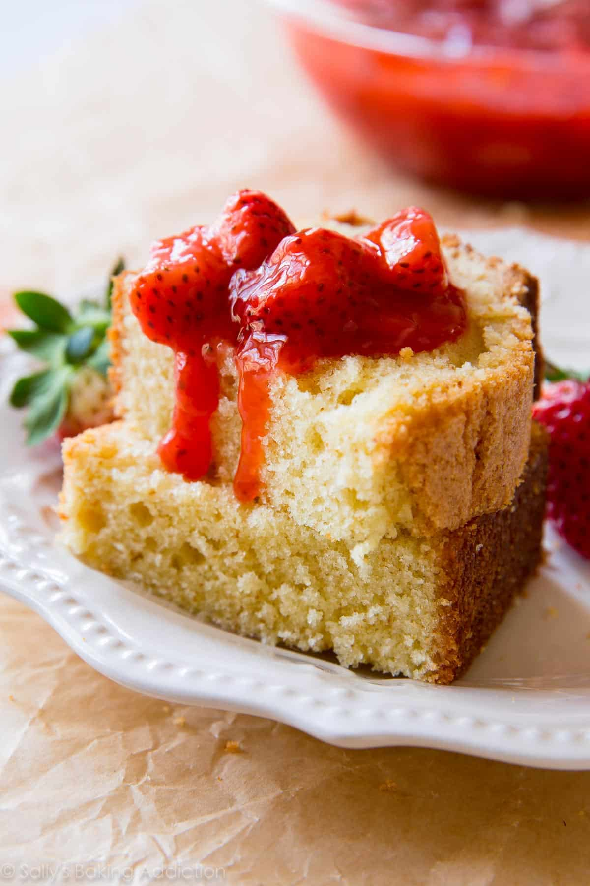 You won't BELIEVE the flavor in this simple brown butter pound cake! Top with strawberry compote. Recipe on sallysbakingaddiction.com