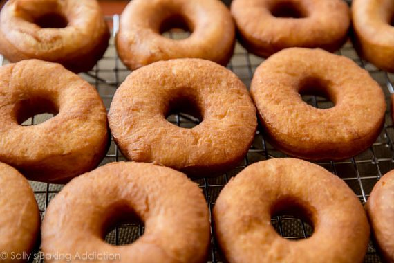 How to make homemade glazed doughnuts on sallysbakingaddiction.com