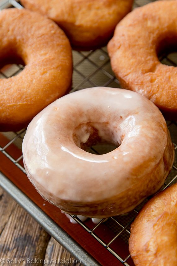 EXACTLY how to make homemade doughnuts! Easier than you think. Step by step pictures and recipe on sallysbakingaddiction.com