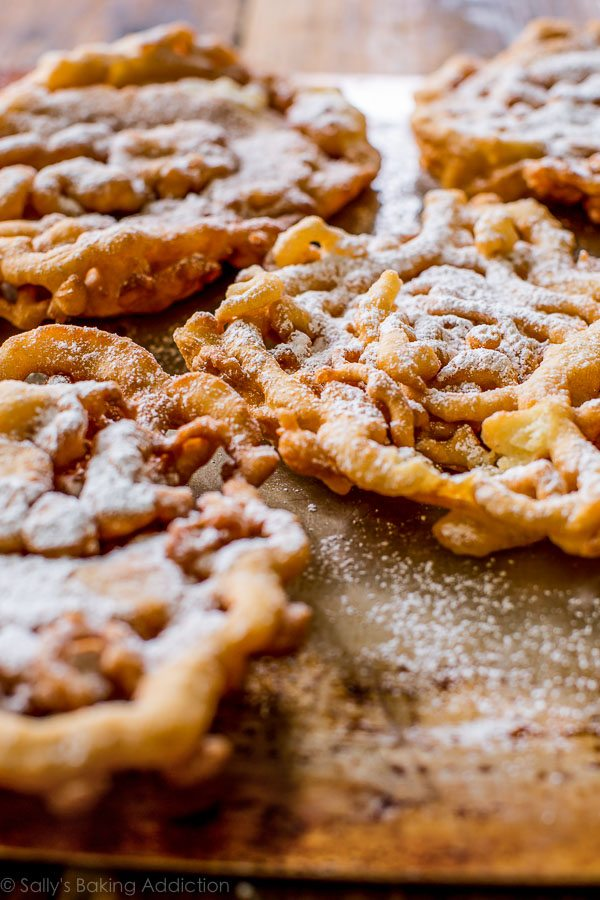Here's exactly how to make homemade funnel cakes! You only need a few basic ingredients to get started. Recipe on sallysbakingaddiction.com