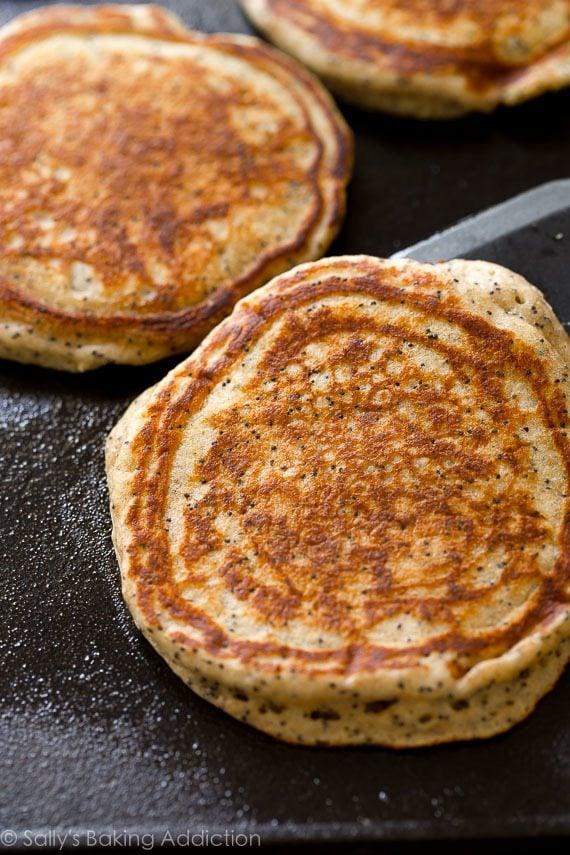 Start your morning right with these whole wheat & FLUFFY Greek yogurt lemon poppy seed pancakes! Recipe on sallysbakingaddiction.com