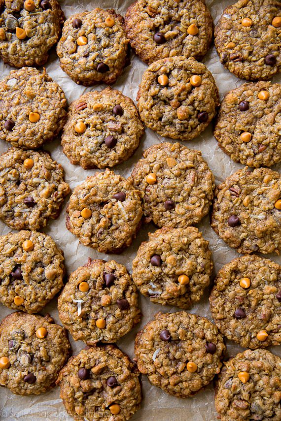 These soft and chewy oatmeal cookies have it all! Chocolate chips, coconut, pecans, butterscotch, and oats. Recipe on sallysbakingaddiction.com